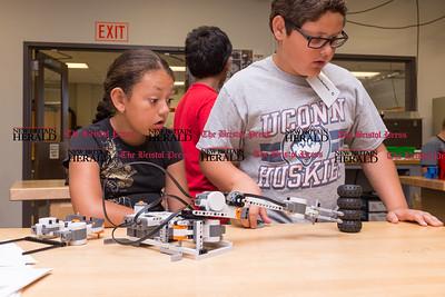 072616  Wesley Bunnell | Staff  Aymara Soler, left, with Nicholas Cordone testing their robotic arm design. Area elementary school students studied Lego/VEX IQ robotics in a weeklong program at CCSU on Tuesday July 26th.