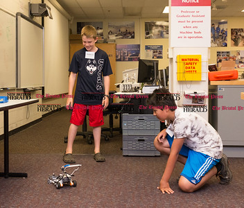 072616  Wesley Bunnell | Staff  Area elementary school students studied Lego/VEX IQ robotics in a weeklong program at CCSU on Tuesday July 26th. From L Nathan Feinberg with Thomas Garcia testing out their lawn mower design.