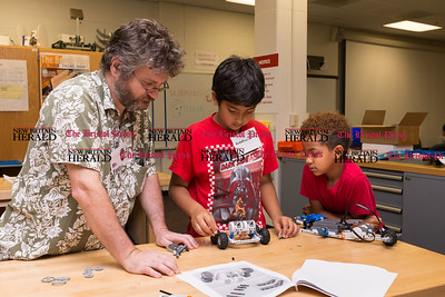 072616  Wesley Bunnell | Staff  CCSU professor Pat Foster works with robotics students Siddharth Krishnan, middle, and Malakai Bowens Otero. Area elementary school students studied Lego/VEX IQ robotics in a weeklong program at CCSU on Tuesday July 26th.