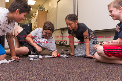 072616  Wesley Bunnell | Staff  From L Thomas Garcia with Nicholas Cordone, Aymara Soler & Nathan Feinberg. Nicholas & Aymara test their baseball pitcher and batter two part robot. Area elementary school students studied Lego/VEX IQ robotics in a weeklong program at CCSU on Tuesday July 26th.