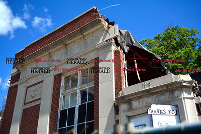 7/27/2016 Mike Orazzi | Staff The old Terryville Trust Building is in the process of being torn down on Route 6 in Terryville.