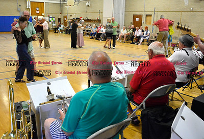 7/26/2016 Mike Orazzi | Staff Seniors dance at the Bristol Senior Center while listening to the Senior 8th Notes on Tuesday.