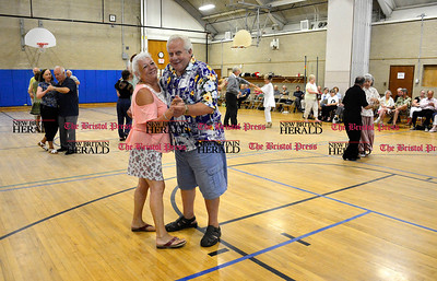 7/26/2016 Mike Orazzi | Staff Eva Schilling and Neil Gagnon dance at the Bristol Senior Center which doubles at cooling center on Tuesday.