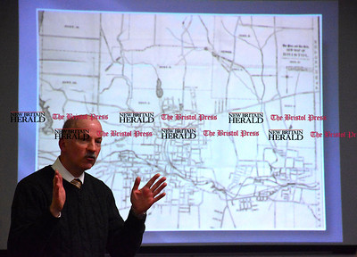 1/10/2015 Mike Orazzi | Staff Bob Adamczyk explains how Bristol streets and geographical areas got their names while at the Manross Library in Forestville on Saturday.