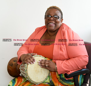 072716  Wesley Bunnell | Staff  Dayna Snell, Executive Director of the Queen Nzinga Center with a Djembe Drum.