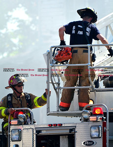 7/26/2016 Mike Orazzi | Staff Bristol and Southington fire crews while battling a smoking house fire at 48 High Street in Southington Wednesday afternoon.