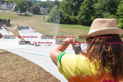 072816  Wesley Bunnell | Staff  Mayor Erin Stewart takes a photo just before heading down the water slide set up for summer campers. The annual pencil hunt at Walnut Hill Park took place on Thursday morning July 28th.