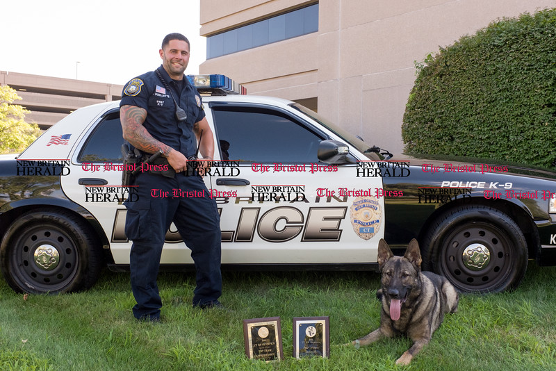 072816  Wesley Bunnell | Staff<br /> <br /> New Britain Police Ofc. Ray Ouellette and Pup with their competition awards. Ofc. Ouellette and Pup recently placed second in the state's police canine competition.