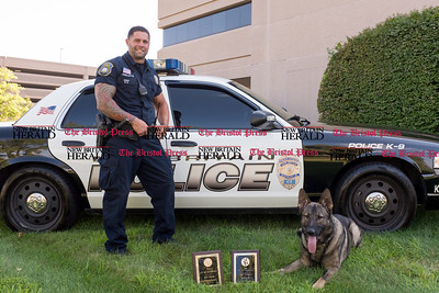 072816  Wesley Bunnell | Staff  New Britain Police Ofc. Ray Ouellette and Pup with their competition awards. Ofc. Ouellette and Pup recently placed second in the state's police canine competition.