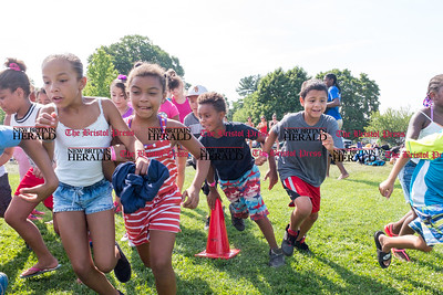 072816  Wesley Bunnell | Staff  The annual pencil hunt at Walnut Hill Park took place on Thursday morning July 28th. Campers run into Walnut Hill Park at the start of the hunt.