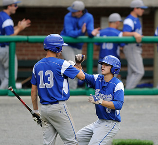 6/4/2016 Mike Orazzi | Staff Bristol Eastern's Brian McPhee (13) and Cory Fradette (8) after scoring during a win in the Class L Quarterfinal at Muzzy Field Saturday.