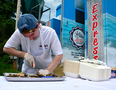 6/4/2016 Mike Orazzi | Staff Nick Carlona of Lenny & Joe's Fish Tale Express opens clams during the 2016 Crazy Beverage and Wine Bash hosted by the The REACH Foundation and Mount Southington Ski Area in Southington Saturday.