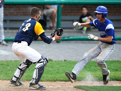 6/4/2016 Mike Orazzi | Staff Bristol Eastern's Brian McPhee (13) tagged out by East Haven's Sam Loda (13) during a BE win in the Class L Quarterfinal at Muzzy Field Saturday.