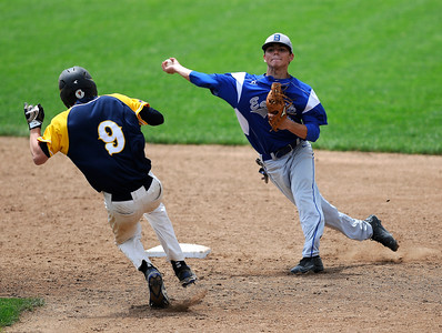 6/4/2016 Mike Orazzi | Staff Bristol Eastern's Cory Fradette (8) starts a double play with East Haven's Jake Ferrara (9) during a BE win in the Class L Quarterfinal at Muzzy Field Saturday.