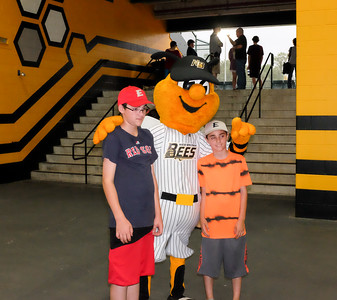 070216  Wesley Bunnell | Staff  The New Britain Bees vs Southern Maryland Blue Crabs during a rain delay. Mascot Sting with from L Nicholas Stanhope & Austin Stanhope  of Enfield.