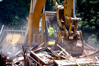 7/12/2016 Mike Orazzi | Staff Tom Catucci of Ludlow Development tears down a building on Muzzy Street across from Muzzy Field in Bristol on Tuesday afternoon.