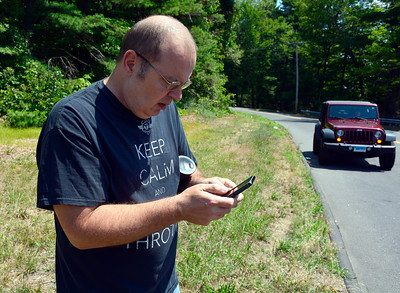 7/13/2016 Mike Orazzi | Staff Mike Nicholas while using the Pokémon GO app on his phone on Cross Street in Bristol near the Lake Avenue Cemetery on Wednesday.