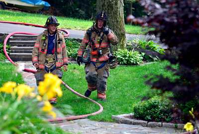 7/14/2016 Mike Orazzi | Staff Members of the Bristol fire department on scene of a house fire at 317 Fern Hill Road Thursday afternoon.