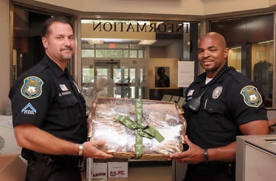 071416  Wesley Bunnell | Staff  Field Training Officer Blain Rogozinski, left, with Officer Anthony Spencer opening a gift basket. An outpouring of support has been received by the New Britain Police Department following the shootings in Dallas on July 7th. More than two dozen gestures of gift baskets along with notes of appreciation have been received.