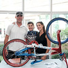 "071516  Wesley Bunnell | Staff<br /> <br /> 10 year old Johnny ""Hot Rod"" Tomboly, a competitive BMX racer on a national BMX race team has dedicated his 2016 season to all military & first responders. His goal is to have 1,000 signatures on his custom painted red,white & blue BMX bike by the 15th anniversary of the terrorist attacks on 9/11.  From L, John Tomboly, Johnny Tomboly & Sandra Tomboly."