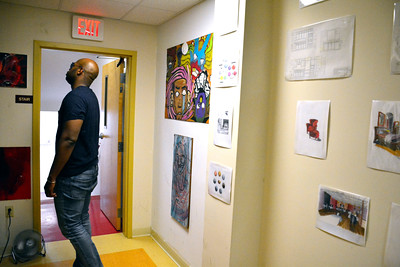 7/16/2016 Mike Orazzi | Staff Miles Elliot looks over artist's work on display during the New Britain 's Artist's Co-op Open Studios on West Main Street Saturday afternoon.