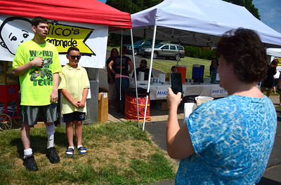 7/16/2016 Mike Orazzi | Staff Chrissy Celentano photographs her son Mikey  with Nico Fasold at Nico's lemonade stand on Northwest Drive in Plainville Saturday morning to raise money for the Make-A-Wish Foundation.