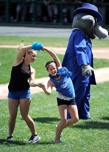 7/19/2016 Mike Orazzi | Staff Chloe Cyr and Angela Ragaini  during a dance off with the Bristol Blues Mascot BB at Muzzy Field Tuesday morning.