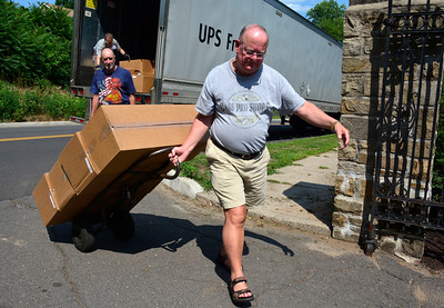 7/19/2016 Mike Orazzi | Staff Bristol Veterans Council member Stanley Piotrowski while receiving a shipment of 6,000 gravesite flags at the West Cemetery as part of the expected 15,000 ordered this year.