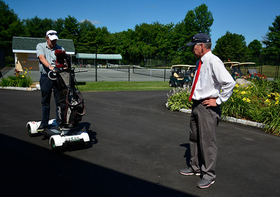 7/20/2016 Mike Orazzi | Staff GolfBoard representative Scott Hinding talks about the features of the battery powered golf cart alternative with Chippanee Golf Pro Gary Sassu.