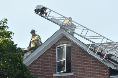 072016  Wesley Bunnell | Staff  112 Wilcox St. in New Britain was damaged by fire on Thursday afternoon. A firefighter sits atop the roof above the 3 family building.
