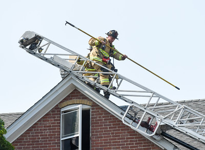 072016  Wesley Bunnell | Staff  112 Wilcox St. in New Britain was damaged by fire on Thursday afternoon. A firefighter makes his way down the ladder from the roof of the 3 family building.