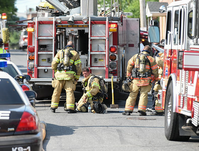072016  Wesley Bunnell | Staff  112 Wilcox St. in New Britain was damaged by fire on Thursday afternoon. Firefighters begin to change out of their gear after putting out the fire.