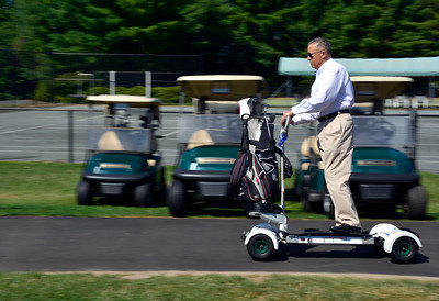 7/20/2016 Mike Orazzi | Staff Chippanee Golf Club President Juan Rodriguez rides a GolfBoard in Bristol Wednesday morning.
