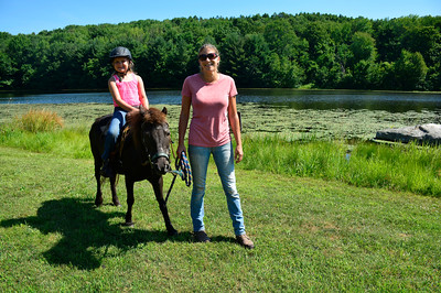 7/21/2016 Mike Orazzi | Staff Christine Breitkreutz and her niece Julia while out with Lily at the Plymouth Recreation area on North Street on Thursday.