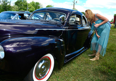 7/2/2016 Mike Orazzi | Staff Kim Freda looks inside a 1941 Ford Business Coupe during the 11th annual Rumblers Nomads RUMBLE IN THE COUNTRY Car and Bike Show at the Terryville Fairgrounds Saturday morning.