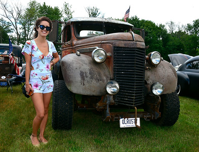 7/2/2016 Mike Orazzi | Staff Stephanie Loza stands next to an old rusted General Motors truck on display during the 11th annual Rumblers Nomads RUMBLE IN THE COUNTRY Car and Bike Show at the Terryville Fairgrounds Saturday morning.