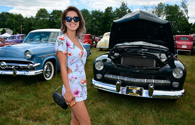 7/2/2016 Mike Orazzi | Staff Stephanie Loza stands next to a 1950 Mercury Convertible on display during the 11th annual Rumblers Nomads RUMBLE IN THE COUNTRY Car and Bike Show at the Terryville Fairgrounds Saturday morning.