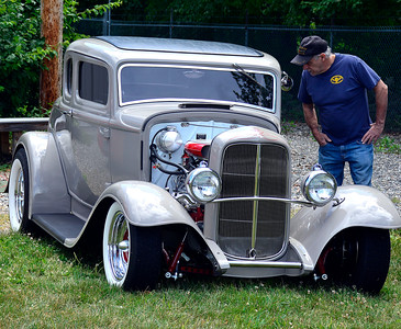 7/2/2016 Mike Orazzi | Staff Carlos Miguel looks at a 1932 Ford Five Window Coupe during the 11th annual Rumblers Nomads RUMBLE IN THE COUNTRY Car and Bike Show at the Terryville Fairgrounds Saturday morning.