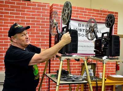 "7/2/2016 Mike Orazzi | Staff Cortlandt Hull with a 16mm film projector  at the Bristol Historical Society on Saturday while preparing to show Alfred Hitchcock's classic thriller - ""SPELLBOUND"" - starring - Ingrid Bergman & Gregory Peck on Saturday."