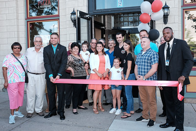 072116  Wesley Bunnell | Staff  Grand Pizza & Restaurant held their grand opening & ribbon cutting on Thursday July 21st.  Mayor Erin Stewart , middle, with owner Tommy Qoku, Val Qoku, family and city officials.