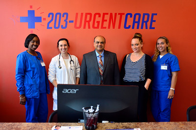 7/21/2016 Mike Orazzi | Staff The recently opened 203-Urgent Care in Southington, left to right: