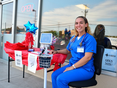 7/21/2016 Mike Orazzi | Staff Jessi Dwy, RMA, outside the recently opened 203-Urgent Care in Southington.