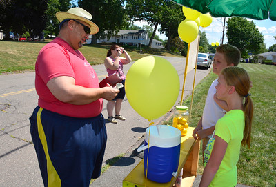 7/23/2016 Mike Orazzi | Staff Andy Clarke and his daughter Jen while buying drinks from Kayden Suchocki and his sister Mave Gunning while selling lemonade to raise money for the Connecticut Humane Society in Newington Saturday.