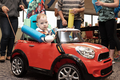 072916  Wesley Bunnell | Staff  Michael Ramsdell, age 13 months, takes his new customized electric car for a spin. Children with disabilities, and their families, were presented with modified toy cars by middle school through college age technology students on Friday July 29th at the CCSU  ITDB building.