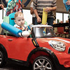 072916  Wesley Bunnell | Staff<br /> <br /> Michael Ramsdell, age 13 months, takes his new customized electric car for a spin. Children with disabilities, and their families, were presented with modified toy cars by middle school through college age technology students on Friday July 29th at the CCSU  ITDB building.