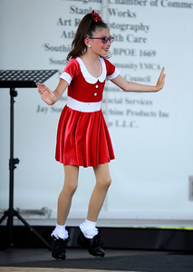 7/29/2016 Mike Orazzi | Staff  Dance City & the Arts' Emily Bennett performs a tap routine during the 12th annual Italian American Festival on lower Center Street in downtown Southington Friday evening.