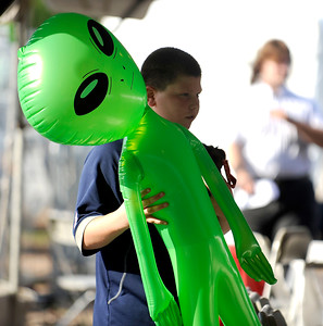7/29/2016 Mike Orazzi | Staff  Connor LaPorta with an inflatable alien he won during the 12th annual Italian American Festival on  lower Center Street in downtown Southington Friday evening.