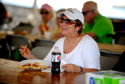 7/29/2016 Mike Orazzi | Staff  Carol Dina enjoys some pizza during the 12th annual Italian American Festival on  lower Center Street in downtown Southington Friday evening.