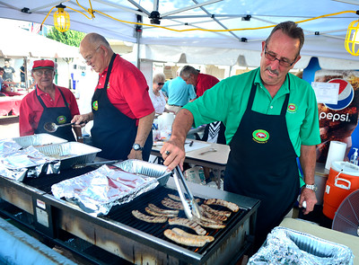 7/29/2016 Mike Orazzi | Staff  Benny Cammuso, Tony Tarfan and Nick Botsacos cooks sausage and peppers during the 12th annual Italian American Festival on lower Center Street in downtown Southington Friday evening.
