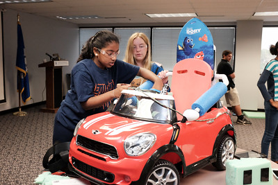 072916  Wesley Bunnell | Staff  Children with disabilities, and their families, were presented with modified toy cars by middle school through college age technology students on Friday July 29th at the CCSU  ITDB building.